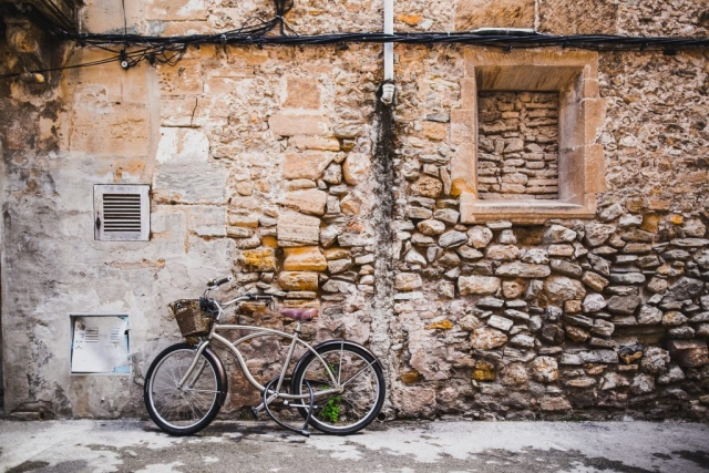 Bike, wall, stones and building